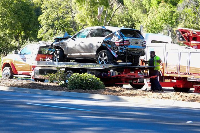 auto draft - woods car 1 - Tiger Woods' wrecked SUV towed after California car crash