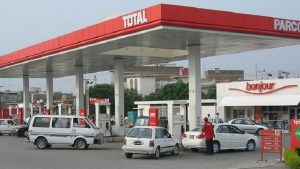 muhammadu buhari - A filling station dispencing fuel 300x169 - Nigerians to now pay N212  for PMS hours after President Buhari promised to reduce the price -report