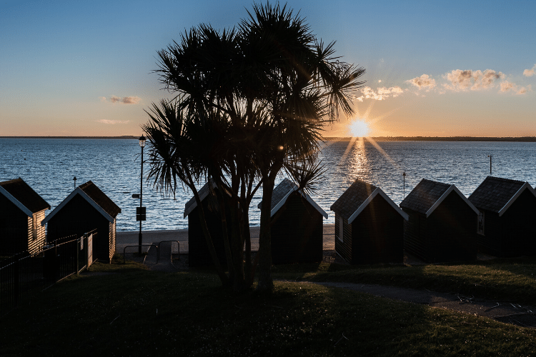Gurnard, near Cowes, Isle of Wight. Beach huts in the sunset.