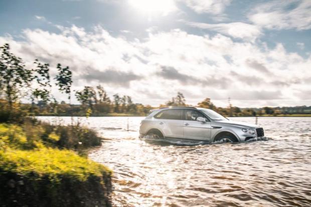 Bentley Bentayga V8 in a lake