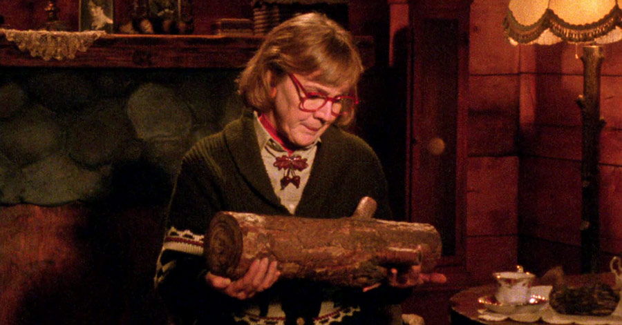 the-log-lady-looking-at-her-log