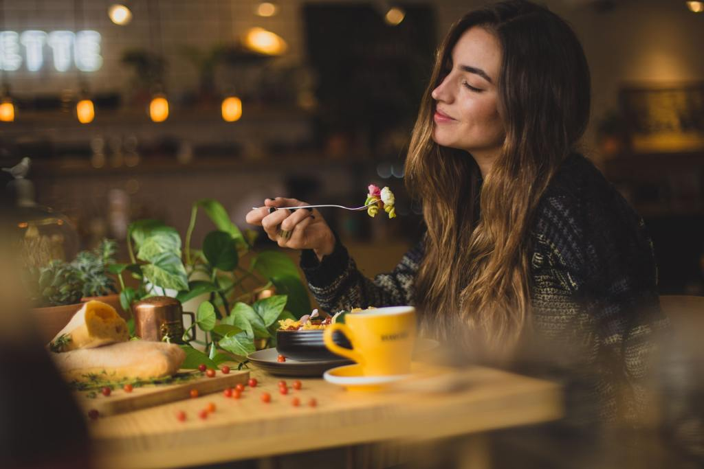 woman eating a meal and enjoying it.