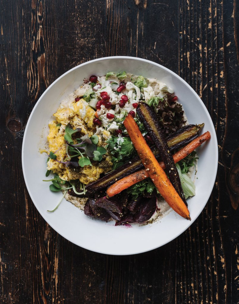 Breakfast with roasted carrots, cauliflower, broccoli, beets, eggs, red lettuce, watercress, pomegranate seeds, and yogurt dressing.