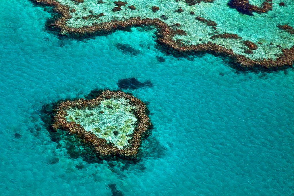 A heart shaped island in the beautiful waters blue and green