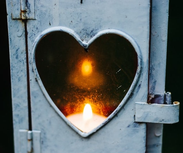 Romantic love depicted in a picture of a candle in a candle box.
