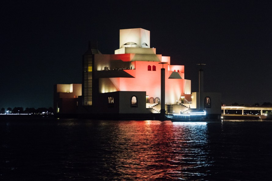 Doha Museum of Islamic Art lit up at night