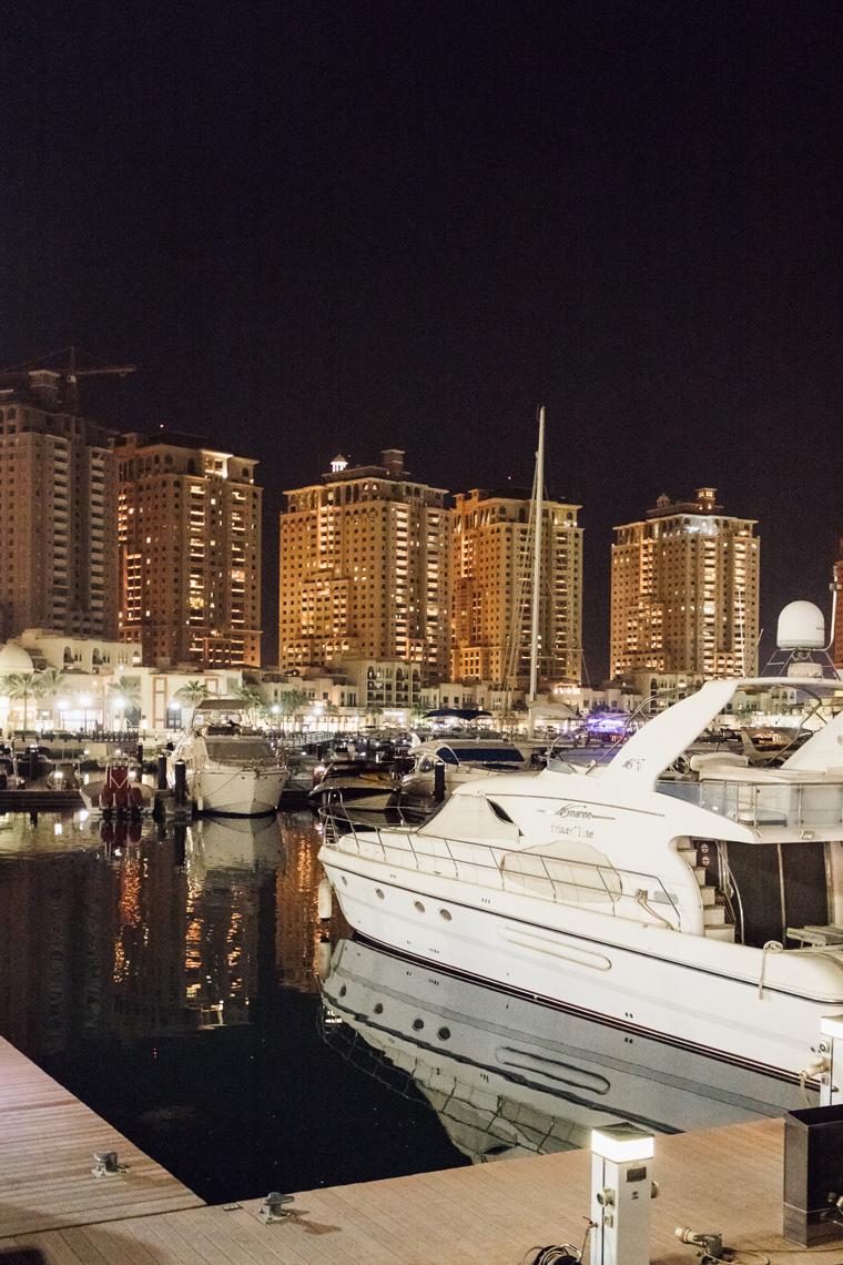 Docked speed boats at night