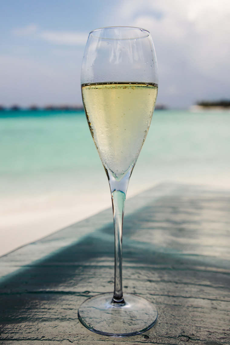 Glass of champagne on the beach