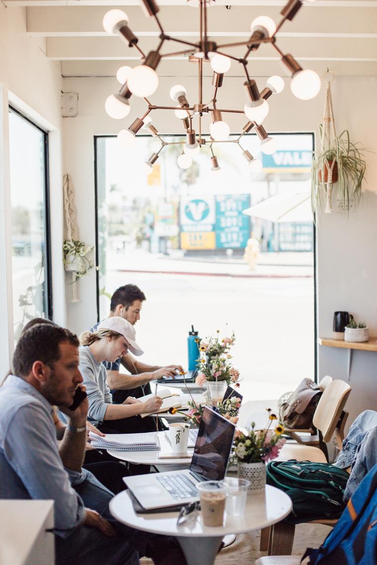 People working on laptops in Communal Coffee
