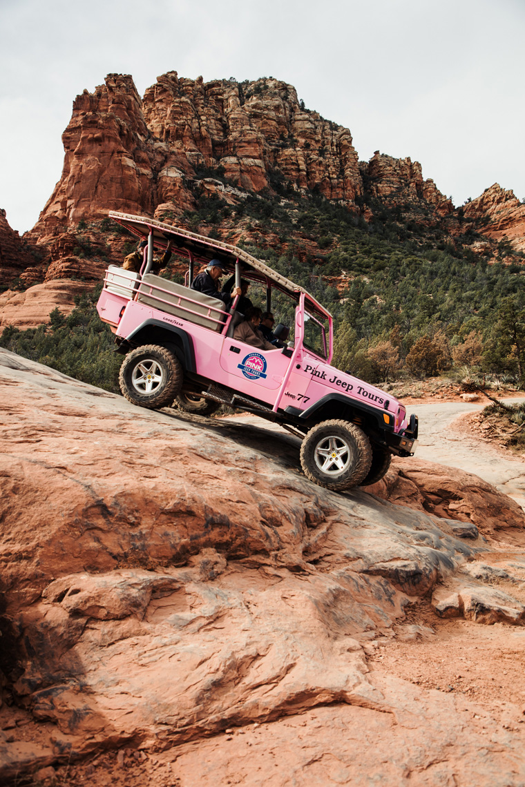 Pink Jeep going downhill