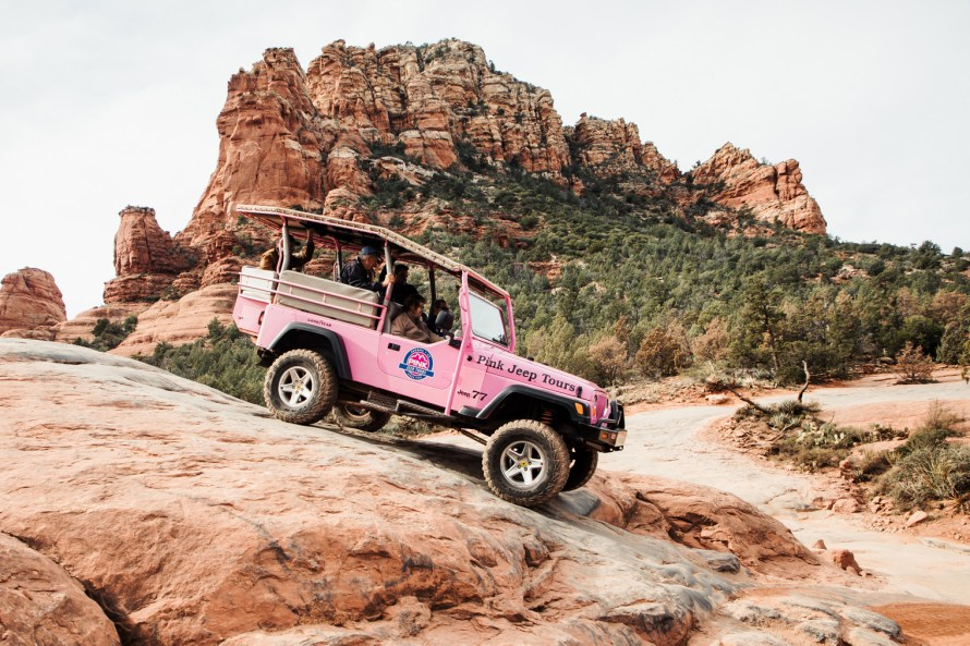 Pink jeep going down steep decline