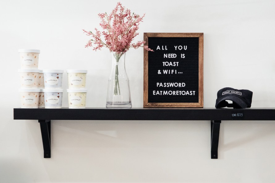 Shelf with flowers and letterboard
