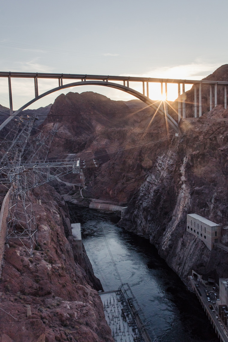 Sun setting behind Hoover Dam