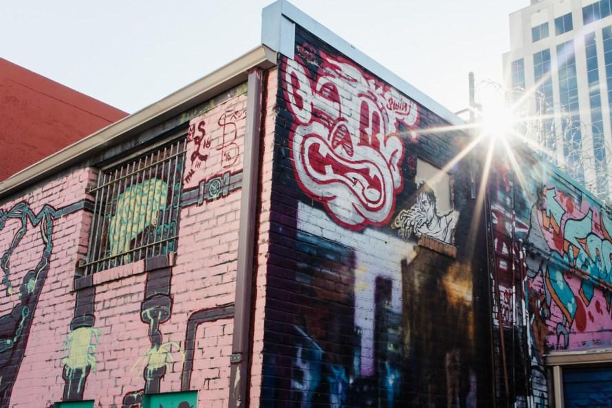 Graffiti mural with sunburst
