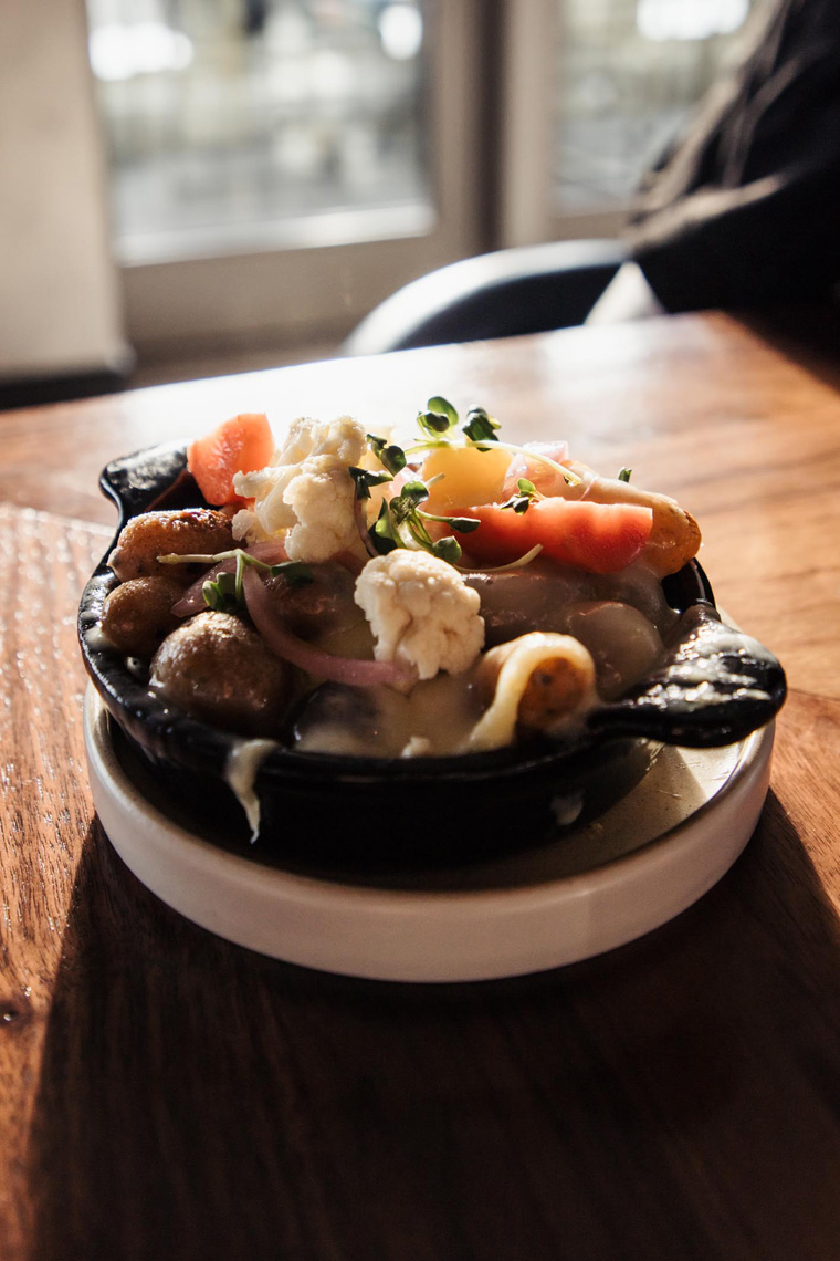 Bowl of vegetables and raclette