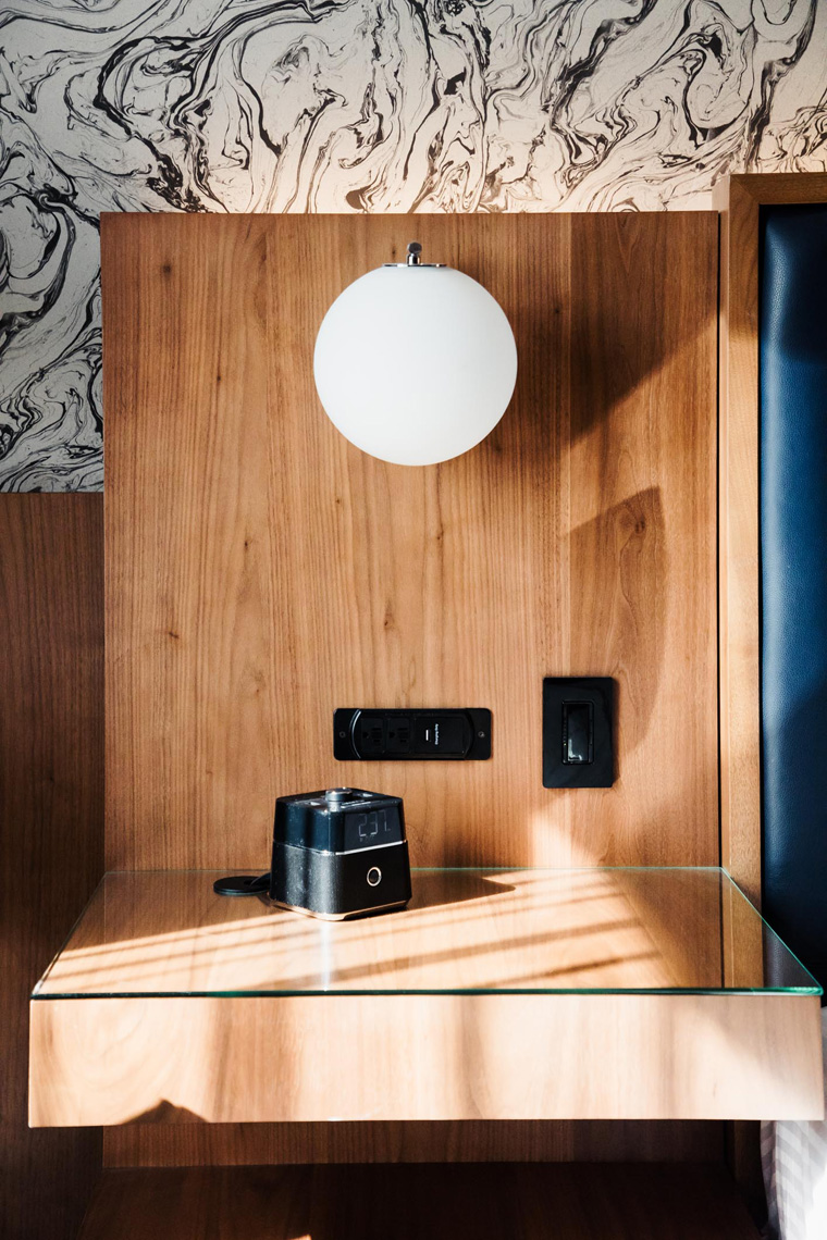 Bedside lamp and outlet