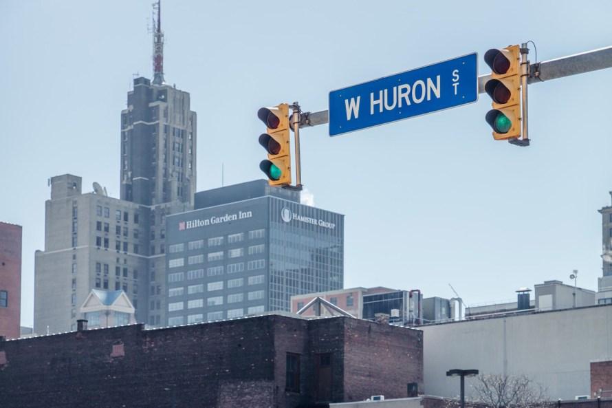 Buffalo skyline with street sign