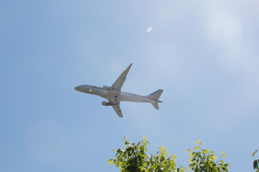 How to build airline miles - American Airlines plane overhead