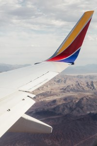 Southwest plane wing over mountains