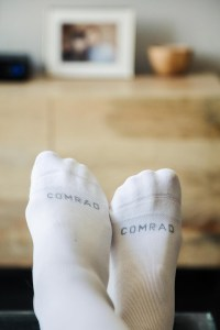 Feet wearing compression socks