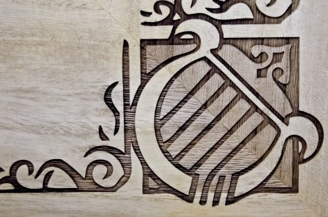 The etch left a deep groove for an inlay, but a light etch also filled the instrument borders.