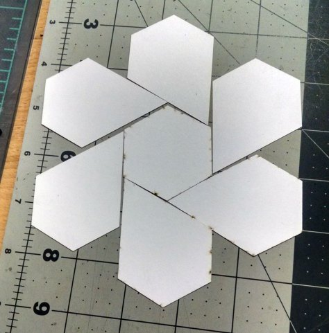 I was having so much fun arranging the cut pieces on our workbench - I call this one twirling bloom.