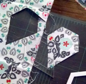 Step 1 for testing my aligning and sewing skills - cutting 6 of the same pattern segment in the jewel shape!