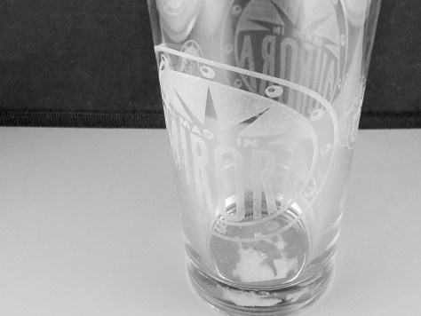 Several engraving tests on one glass show off how images can be warped by bad diameter settings.