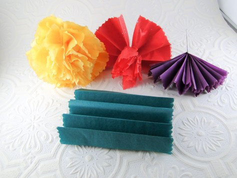 Stages of making a flower - blue is the fan fold, purple is attaching the wire around the middle, red is the fluffing stage with only he first layer separated, and yellow is the final bloom.