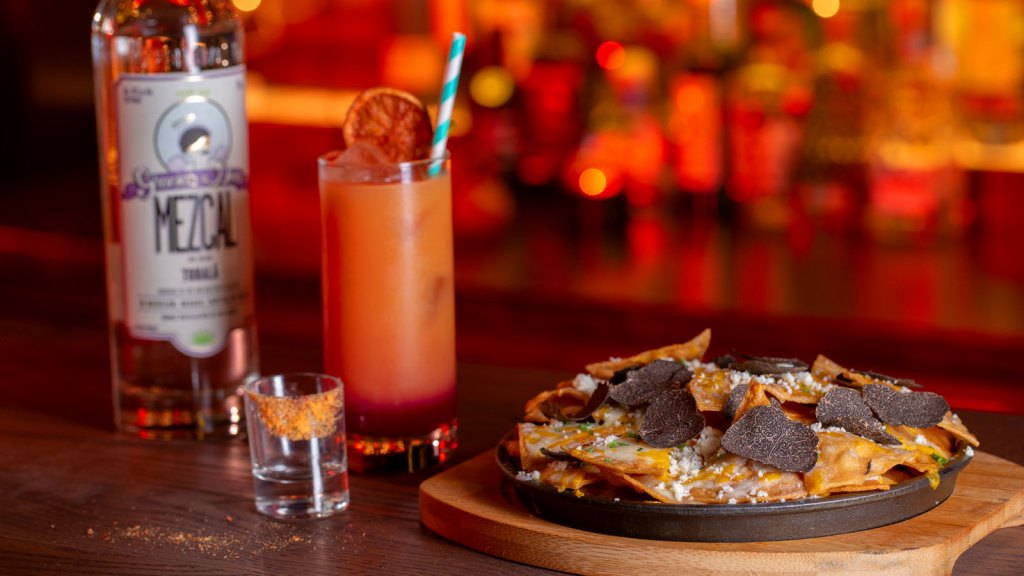 Mezcal cocktail and nachos at Ghost Donkey