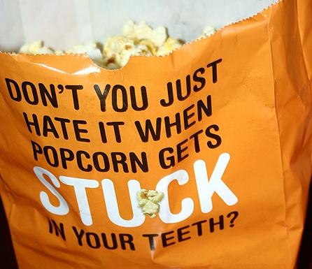 hate it when popcorn stuck in teeth