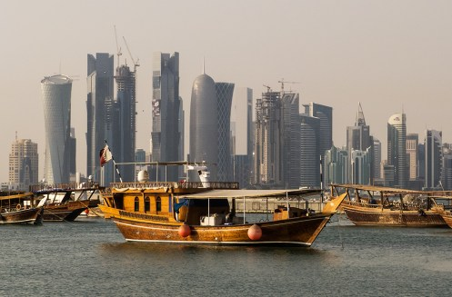 Evening view of the West Bay skyline from the Corniche in Doha, Qatar. Photo by StellarD