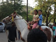 Horse riding with my cousin.