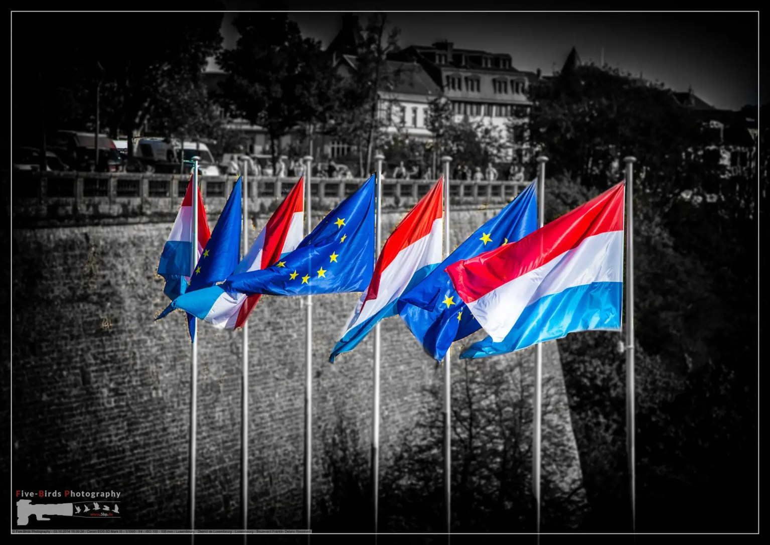 Waving flags of Luxembourg and the European Union in the city of Lucembourg