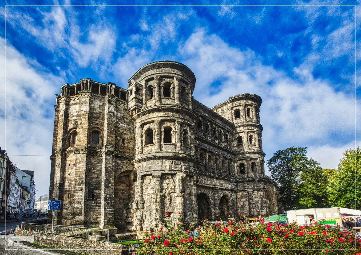 Photography of the Porta Nigra, a large Roman city gate in Trier, Germany.