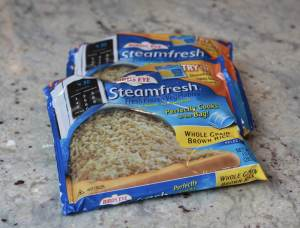 2 Microwaveable frozen rice steamer bags on a countertop.
