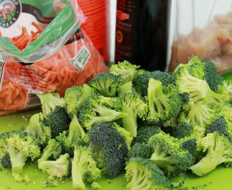 Freshly cut broccoli spears and carrot shoots in a baggie.