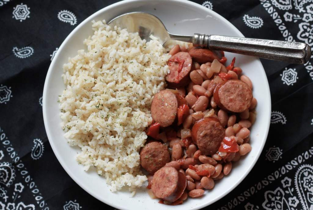 Slow Cooker Cajun Beans with Sausage. So good. So easy. Love the recipes on this site. Super simple. | 5dinners1hour.com