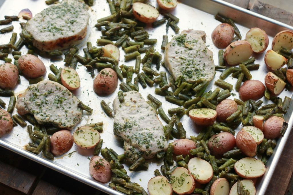 ONE PAN Ranch-y Pork Chops Dinner. We LOVED this. Not a crumb leftover. Super easy, all on one pan. Love the recipes on this site. Always super easy and so good. | 5dinners1hour.com