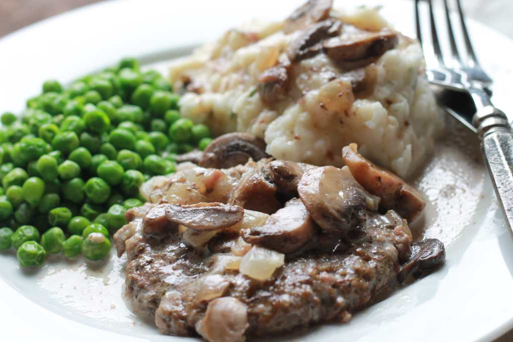 Slow Cook Salisbury Steak in Cream Gravy. Shut the front door, this is heaven on a plate! | 5dinners1hour.com