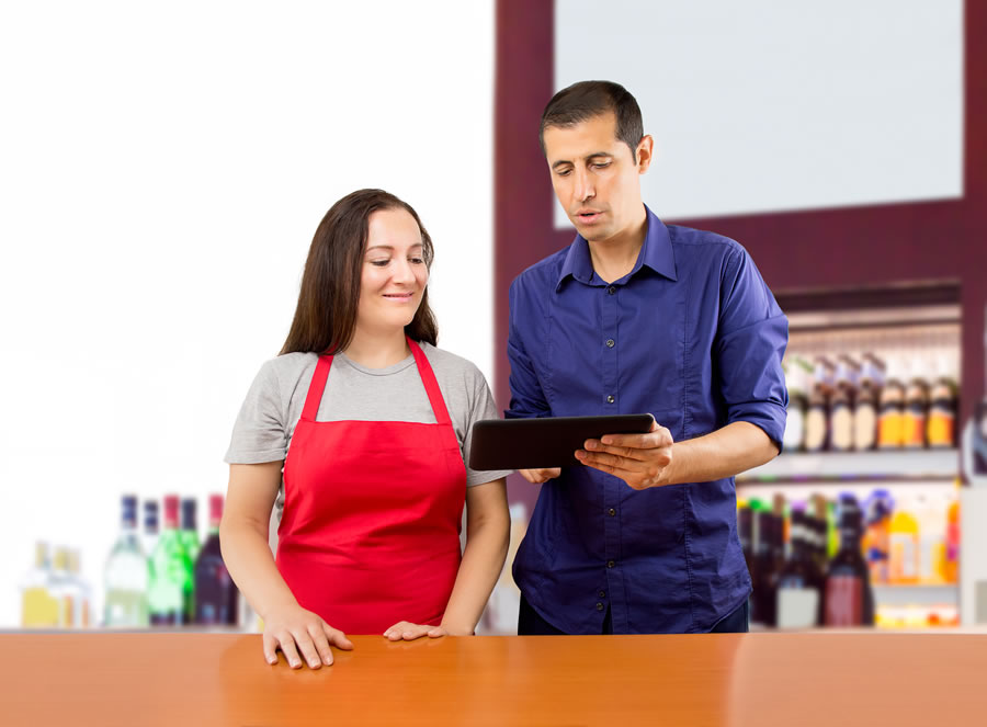 Employees reviewing sales goals for contest