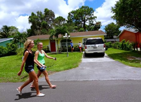 Green Bay visits Naples (summer 2014) - STM team members canvassing - putting invitations in the door jams - in the Florida sunshine