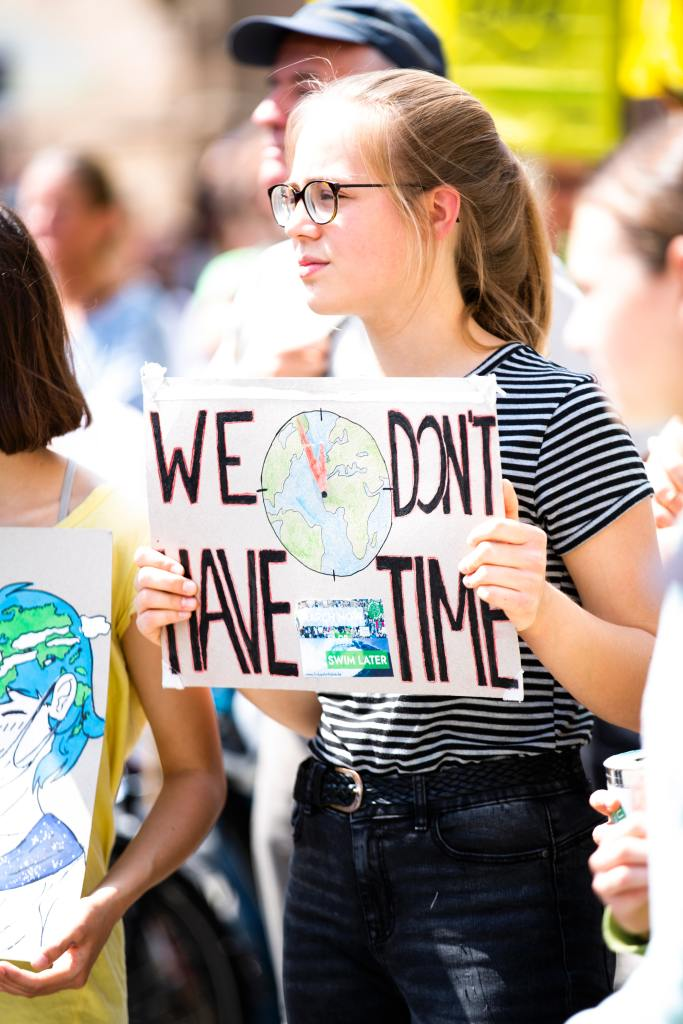 Activist wearing sign 'We don't have time'