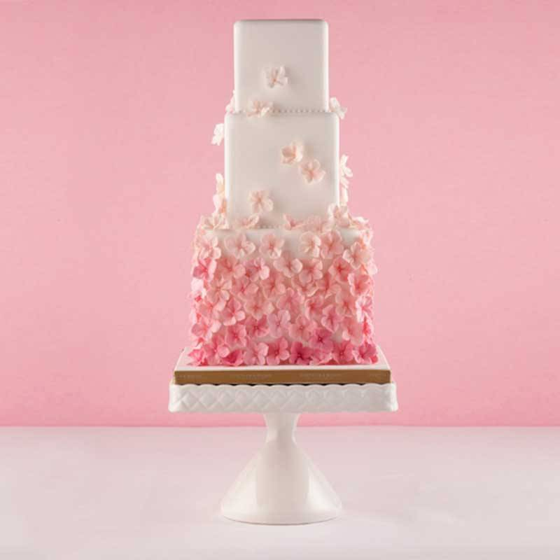 Blossom Cake - Inspired by delicate wedding blooms with petals falling like confetti.