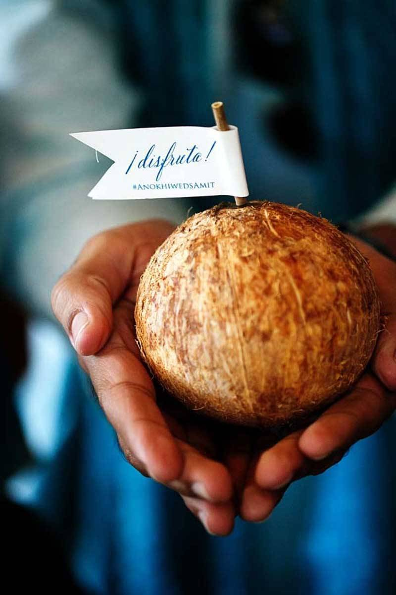 Indian groom holding a coconut