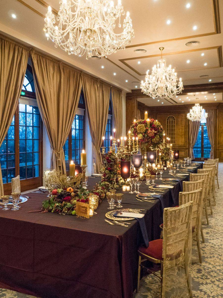 Soft candlelight and sparkling chandeliers illuminate the luscious blooms