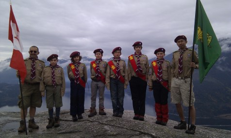 "Four newly invested scouts. The 5th West Van Scout Troop is reborn! (our group's scarf will be different from these...we needed some ""stand-ins"" while our real ones are being made - thanks to ZoneWest for the loan - our real scarf will be burgundy & gold)"
