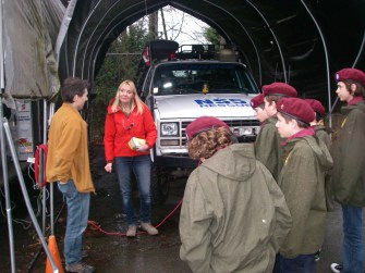 Connie introduces the team's training officer to the Scouts.