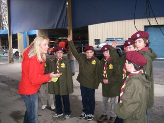 """Connie tests the Scouts' backcountry survival knowledge. The Scouts surprised her with their knowledge and explained that they follow NSR's """"Ten Essentials"""" list from the NSR website."""