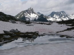 Tuesday: Day 1's objective, Cheops, is reflected in the melt water at the Rangers' Hut ridge at the 7,000 foot level on the way up Mt. Abbott (8,087 ft./2,465 m) across the valley from Cheops. Unfortunately, heal blisters stopped my progress up the mountain (luckily I later sorted the problem out and continued the week unaffected by my damaged heals). While the rest of the team made good progress further up Mt. Abbott, they were again forced to turn around without summiting due to bad weather (torrential rain and hail).